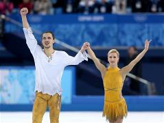 Tatiana Volosozhar/Maxim Trankov win gold in pair skating